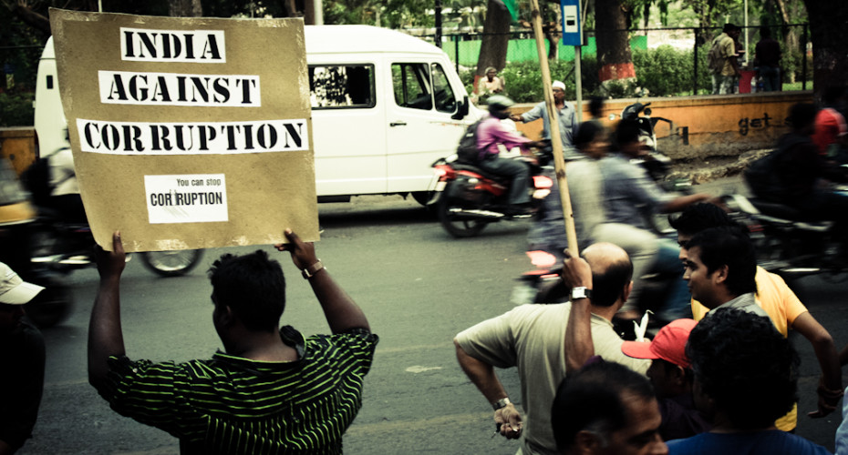 A protester in Pune. Credit: Wikimedia Commons.