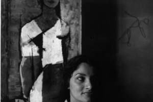 A photograph clicked in 1956 shows Indrani Rahman sitting by the Husain's original portrait. Credit: Ram Rahman