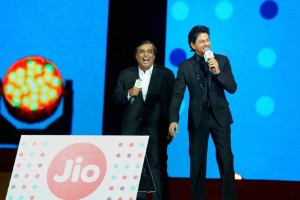 Mukesh Ambani and Shah Rukh Khan at a Reliance Jio event. Credit: PTI