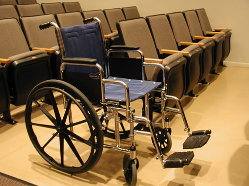 Wheelchair seating in a theatre (i.e. giving a dedicated, convenient space left free for a user to position their own wheelchair in the cinema) Public spaces in India are rarely disabled-friendly. Credit: Wikipedia Commons