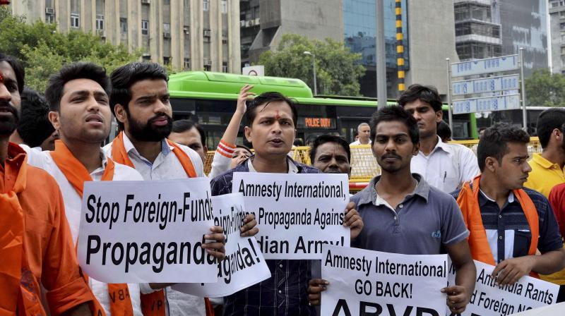 ABVP activists shout slogans at a protest against Amnesty International India in New Delhi. Credit: PTI