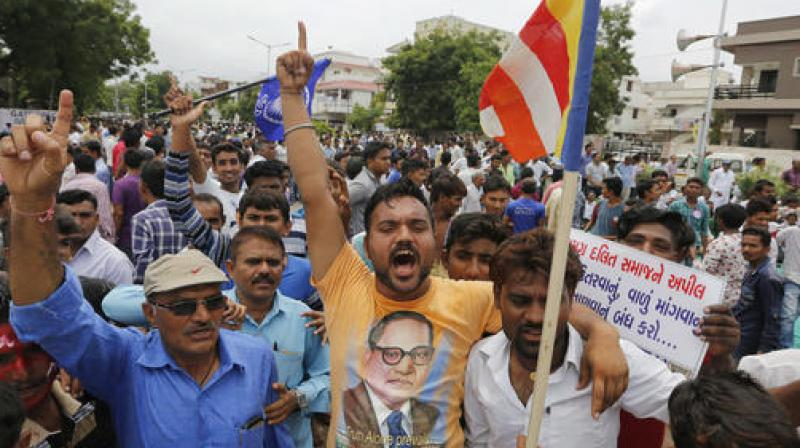 Dalit community members shout slogans at a protest rally in Ahmadabad. Credit: PTI