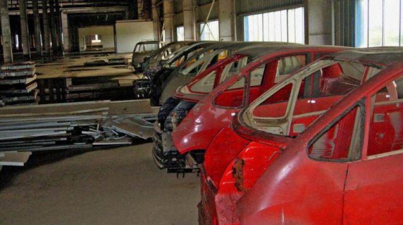 Nano car shells at the abandoned Tata Motors' factory at Singur in Hooghly district. Credit: PTI