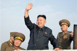 North Korean leader Kim Jong-Un (C) waves as he visits military units on islands in the most southwest of Pyongyang in this picture released by the North's official KCNA news agency in Pyongyang August 19, 2012. Credit: REUTERS/KCNA