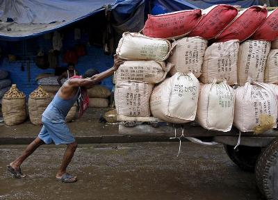 A labourer loading a goods truck. Credit: Reuters