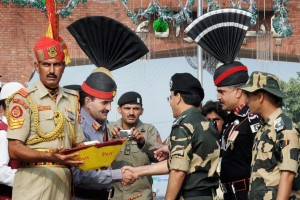 Pakistan Rangers present sweets to Indian bordr guards on August 14, Pakistan's independence day. Credit: PTI