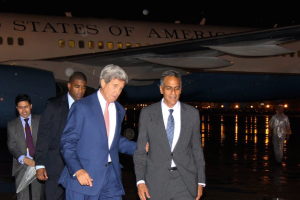 US Secretary of State John Kerry with US ambassador to India Richard Verma, at Delhi airport on Monday night. Credit: PTI
