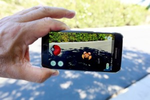 "The augmented reality mobile game ""Pokemon Go"" by Nintendo is shown on a smartphone screen in this photo illustration taken in Palm Springs, California. Credit: Reuters/Sam Mircovich/Illustration"