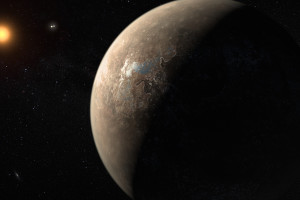 This artist's impression shows the planet Proxima b orbiting the red dwarf star Proxima Centauri, the closest star to the Solar System. The double star Alpha Centauri AB also appears in the image between the planet and Proxima itself. Proxima b is a little more massive than the Earth and orbits in the habitable zone around Proxima Centauri, where the temperature is suitable for liquid water to exist on its surface. Caption and credit: ESO/M. Kornmesser