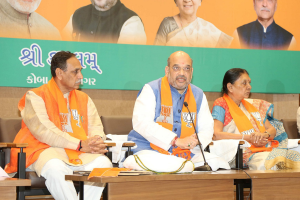 File photo of Gujarat BJP chief, Vijay Rupani (left), named on Friday as the state's new chief minister, sitting next to BJP president Amit Shah and Anandiben Patel, who announced her resignation as CM earlier this week. Credit: Amit Shah's blog
