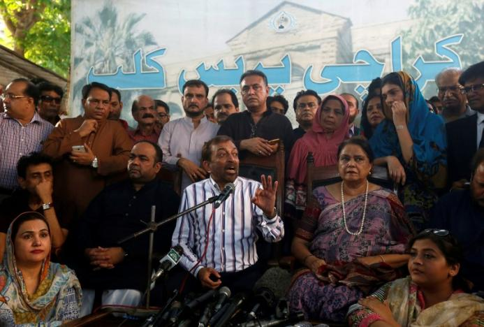 Farooq Sattar (C), leader of Muttahida Qaumi Movement (MQM) political party, gestures while addressing a news conference along with party members at the Press Club, in Karachi, Pakistan, August 23, 2016. Credit: REUTERS/Akhtar Soomro