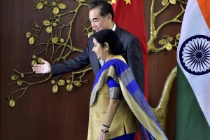External Affairs Minister Sushma Swaraj with her Chinese counterpart Wang Yi during a meeting in New Delhi on Saturday.  Credit: PTI/Kamal Kishore