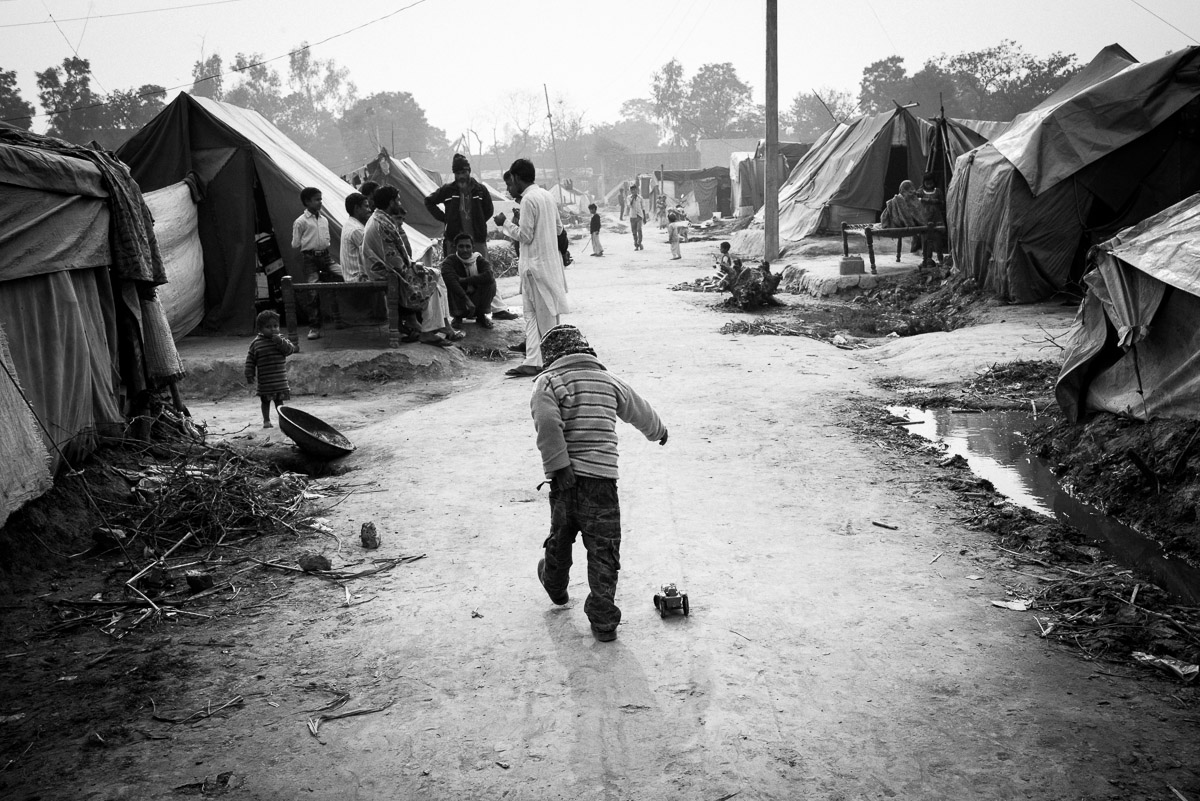 Children, the worst affected and one of the most vulnerable group, were oblivious in many places to the reality surrounding them. December 2013, Muzaffarnagar. Credit: Asif Khan