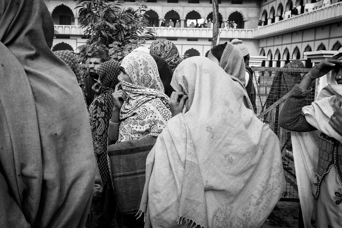 A group of women waiting for relief material to be distributed. Following concerted campaigns, aid had started arriving in time to help people face the bleak winter months. December 2013, Muzaffarnagar. Credit: Asif Khan