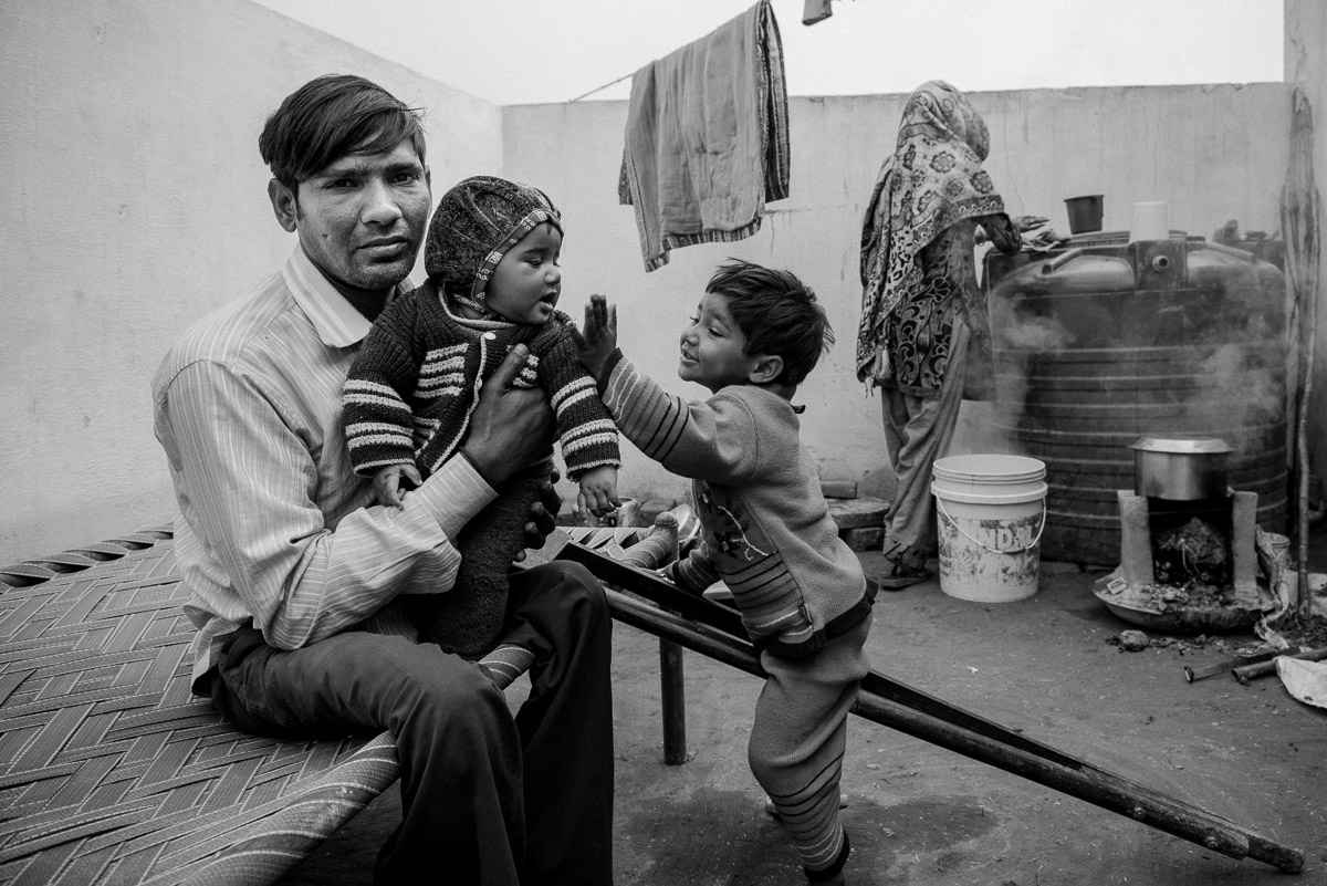 Mohammad Jabbar with his family. A tailor by profession, he was allotted a house in one of the rehabilitation colonies built by a charitable organisation. Having lost his sewing machine, he was helped by relatives who arranged for one to help him go back to earning a living. March 2014, Muzaffarnagar. Credit: Asif Khan