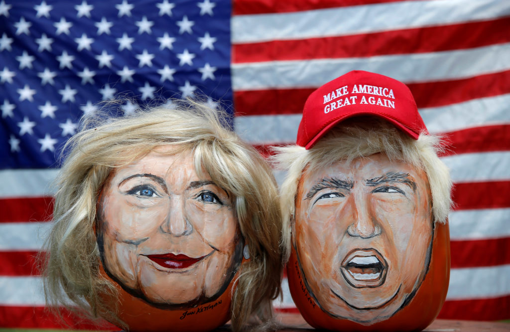 The images of US Democratic presidential candidate Hillary Clinton (L) and Republican Presidential candidate Donald Trump are seen painted on decorative pumpkins created by artist John Kettman in LaSalle, Illinois, US. Credit: Reuters/Jim Young