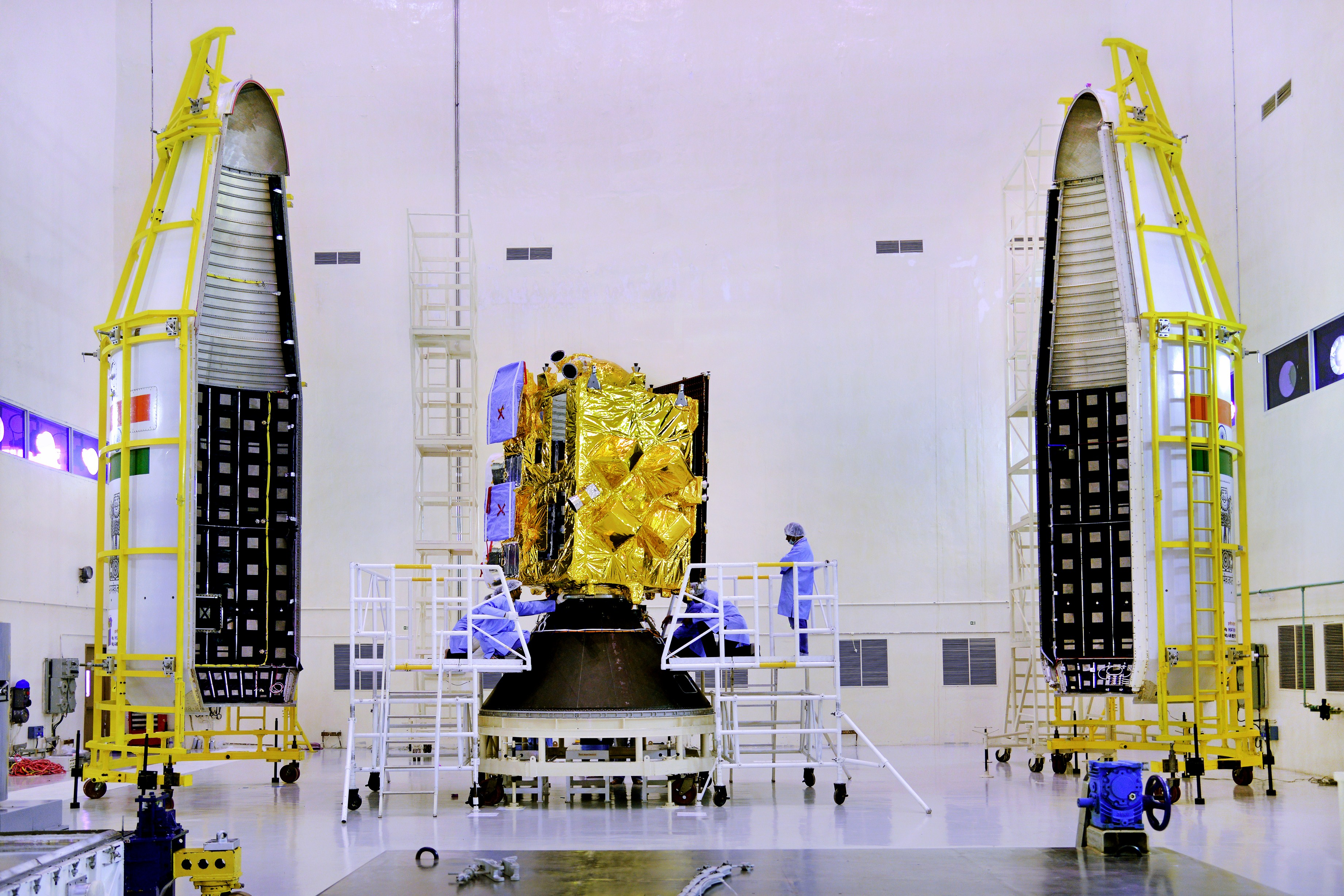 The INSAT-3DR satellite. The two halves of the GSLV-F05's payload fairing are seen to either side. Credit: ISRO