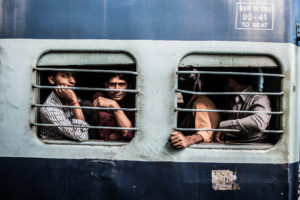 Men waiting on a train from Rishikesh to Chandigarh. Credit: Ringnam Wangkhang/ flickr/CC BY 2.0