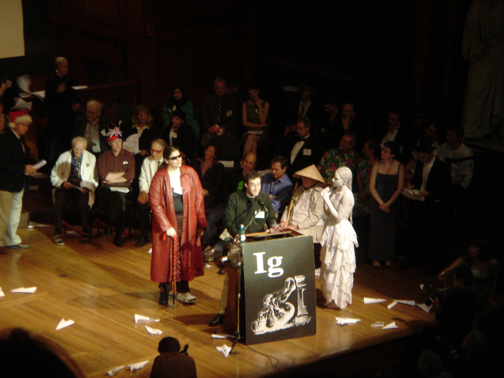 The Ig Nobel Prize ceremony in 2006. Paper planes are visible on the stage. Credit: jdlouhy/Flickr, CC BY 2.0