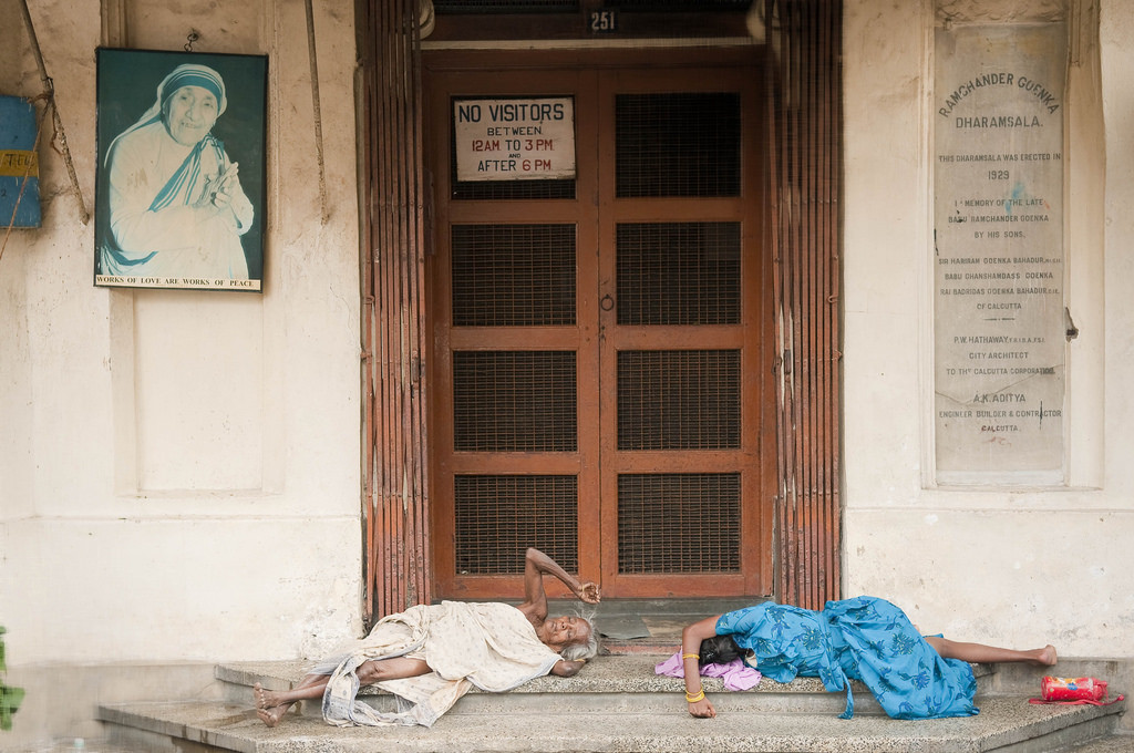 People laid down at Mother Teresa's Mother House. Credit: M M/flickr/CC BY-SA 2.0
