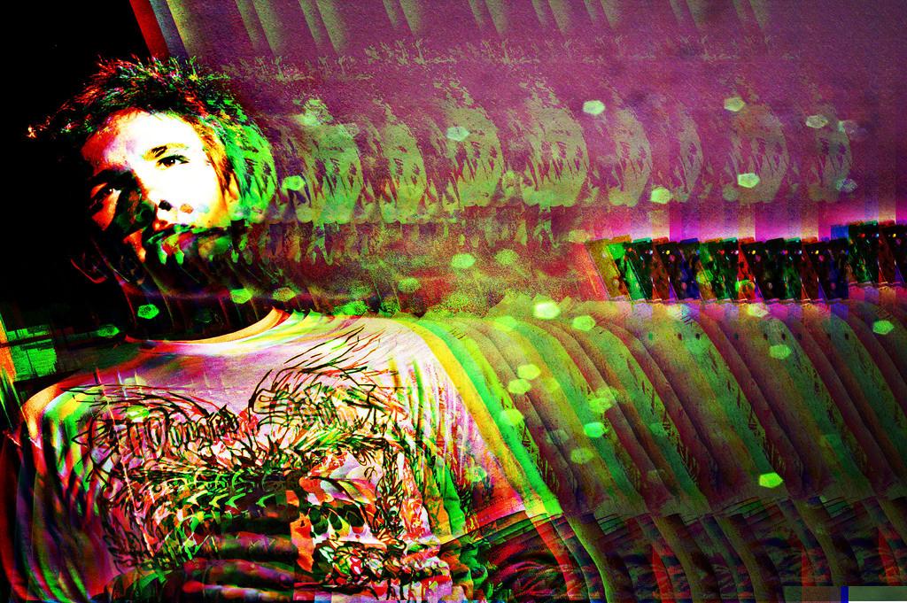 How Does LSD Induce Short-Term Psychosis but Long-Term Optimism?