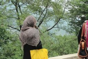 Women clad in burqas walk along a road near Dewal Sharif   Annie Ali Khan