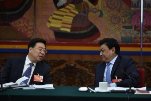 Wu Yingjie (L), deputy party chief of Tibetan Autonomous region, speaks to Padma Choling (R), Chairman of the People's Congress of Tibetan Autonomous region, during Tibet delegation group discussion at the ongoing National People's Congress (NPC), China's parliament, in Beijing, China, March 7, 2016. Credit: Reuters/Stringer/Files