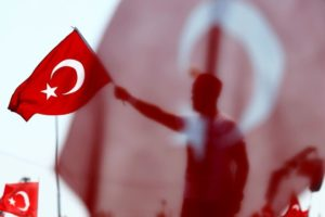 A man waves Turkey's national flag during the Democracy and Martyrs Rally, organized by Turkish President Recep Tayyip Erdogan and supported by ruling AK Party (AKP), oppositions Republican People's Party (CHP) and Nationalist Movement Party (MHP), to protest against last month's failed military coup attempt, in Istanbul, Turkey, August 7, 2016. Credit: Reuters/Umit Bektas