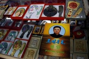 "A stamp album with a portrait of the late North Korean leader Kim Jong-il is on display in a souvenir shop in Dandong, Liaoning province, China, across the border from North Korea, September 12, 2016.  The Korean writing reads, ""Korean stamps"". Credit: Reuters/Thomas Peter"