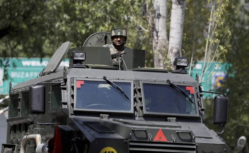 A soldier guards the army base in Uri which was attacked by militants on September 18. Credit: PTI