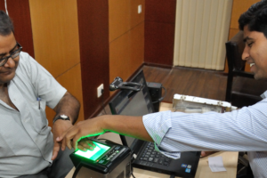 Biometric data collection for Aadhaar cards. Credit: Biswarup Ganguly/Wikimedia Commons