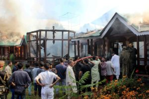 Locals, army and fire fighters try to douse the major fire at Hanafia High School in the Anantnag district of south Kashmir on Monday. Credit: PTI