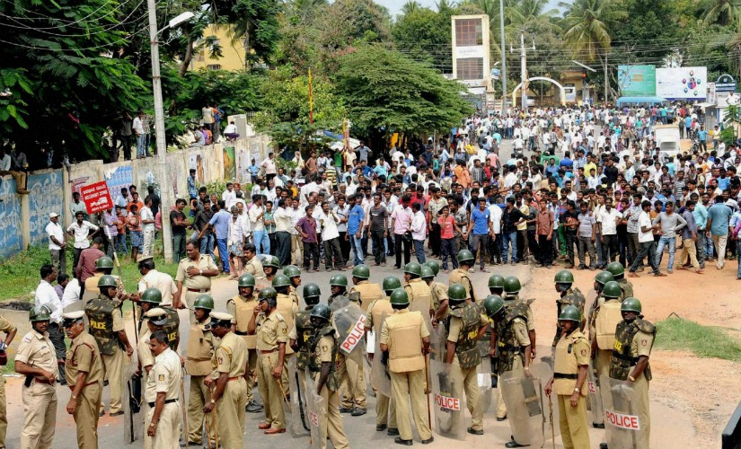 Police facing protestors in Bengaluru, earlier this week. Credit: PTI