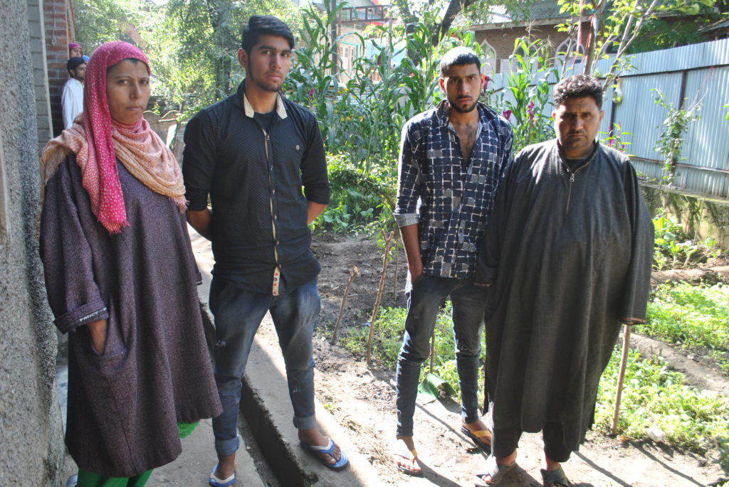 The family of 20-year-old Javed Ahmed Sheikh, a barber. Credit: Rohini Mohan
