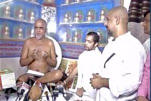 Vishal Dadlani with Jain monk Muni Tarun Sagar. Credit: ANI screengrab/Twitter