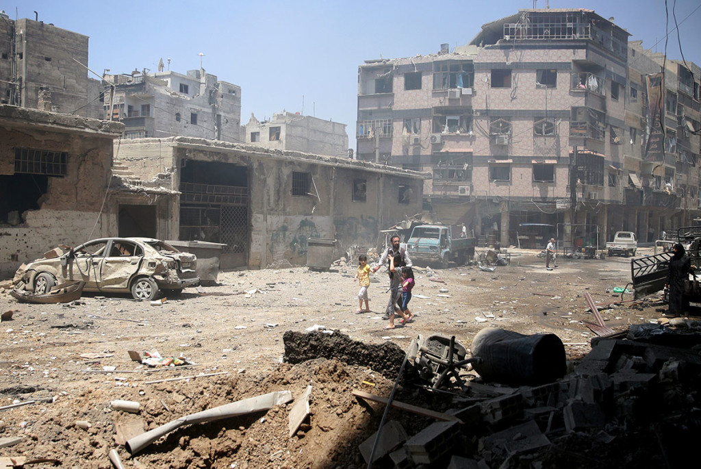 The aftermath of a government airstrike on the outskirts of Damascus. Credit: Reuters