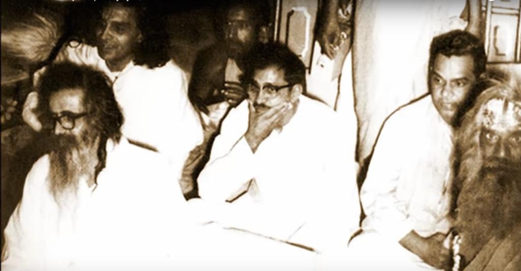 Deendayal Upadhaya, seated between a young Atal Bihari Vajpayee and the older M.S. Golwalkar, head of the RSS. Screen grab from YouTube/Deendayal Upadhyaya | Jeevan Darshan, a film directed by Vinay - Samaksh
