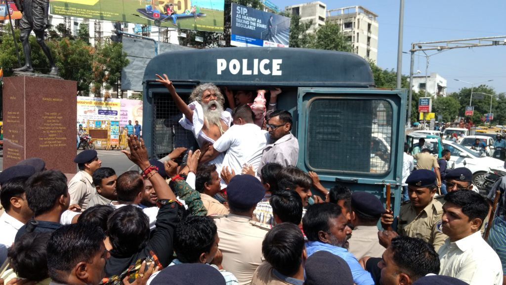Protesters being detained by the police. Picture credit: Damayantee Dhar