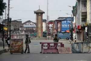 Security personnel guarding at Lal Chowk during curfew in Srinagar on Tuesday. Credit: PTI/S. Irfan