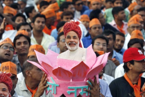 A supporter of Narendra Modi wears a headgear with a portrait of Modi during a rally ahead of the 2014 general elections. Credit: Reuters/Amit Dave/Files