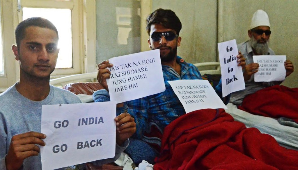 Victims of pellet injuries hold up pro-freedom placards in SMHS. Credit: Rohini Mohan