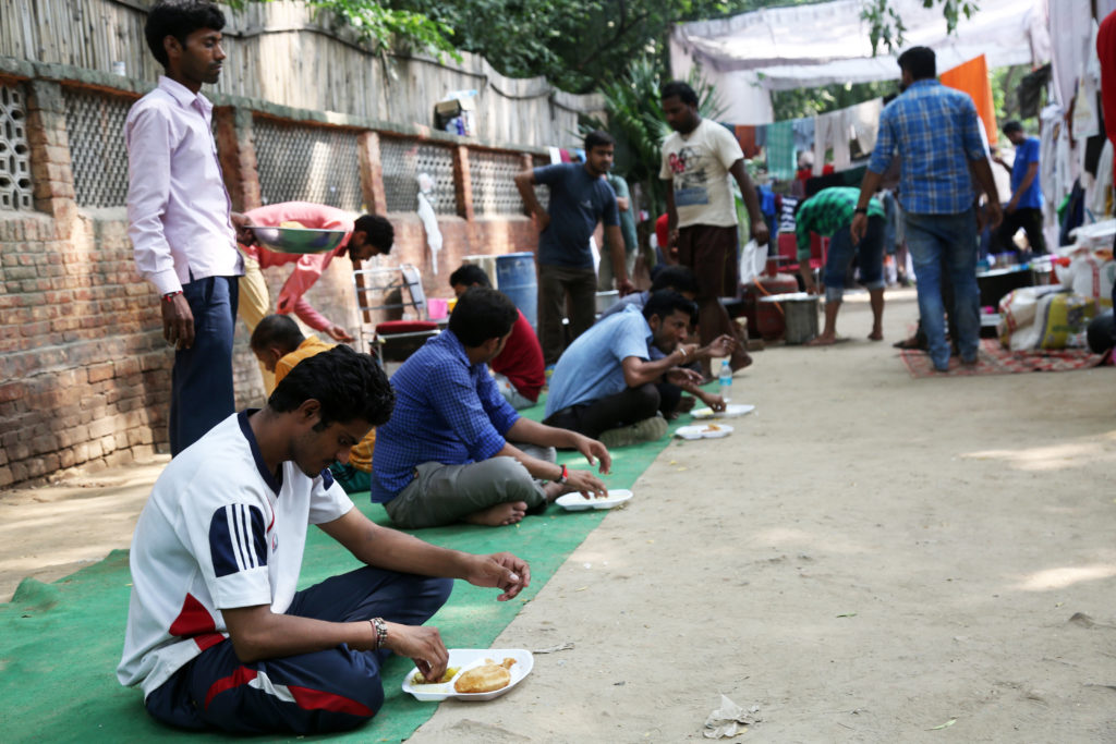 Lunch being served at the community kitchen, an effort funded by workers, activists, unions, and students. Credit: Hina Fathima