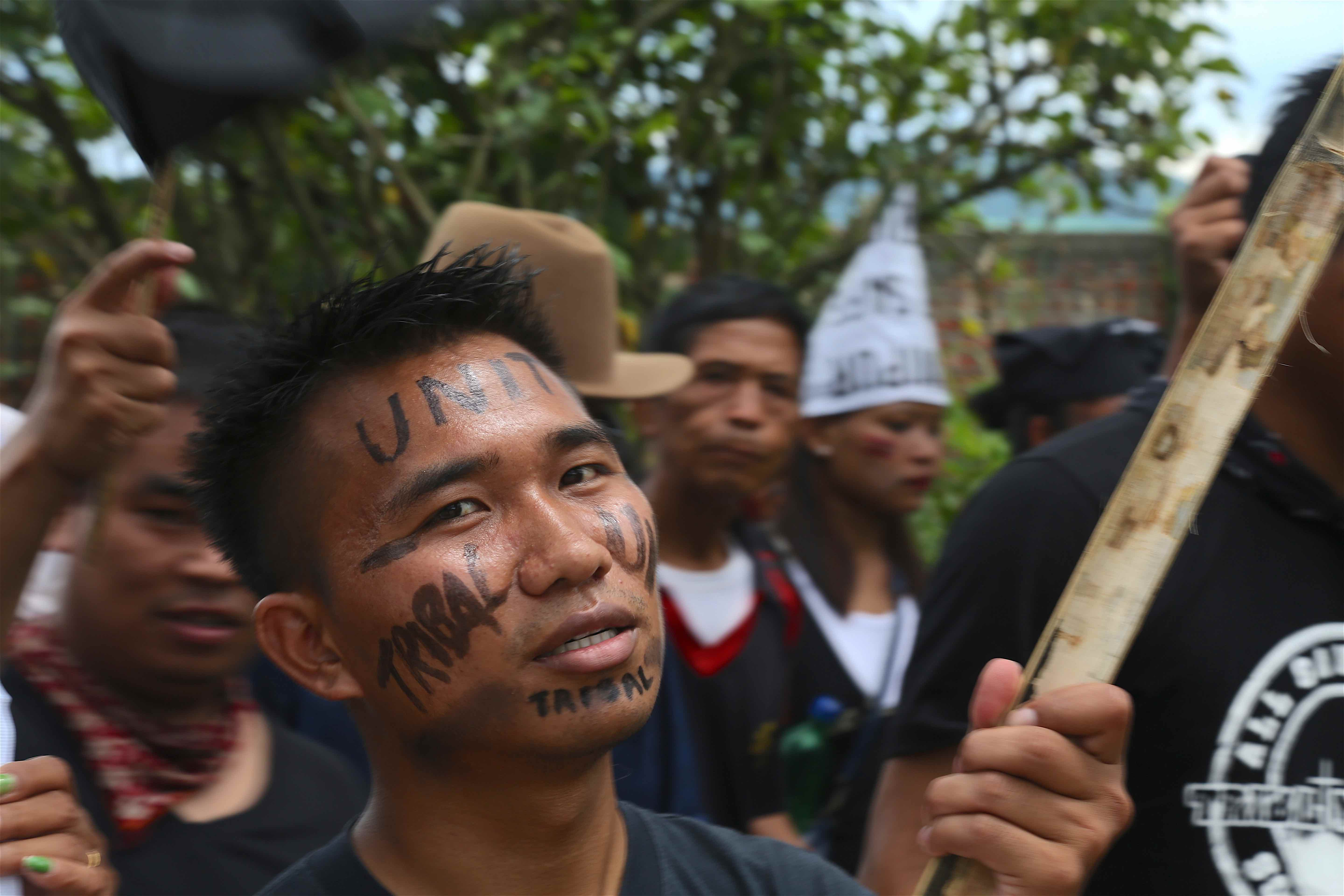 """Many young men painted """"tribal unity"""" on their faces. Credit: Akhil Kumar"""