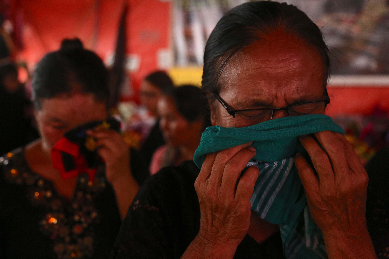 Women wipe tears at the protest, Churachandpur, August 31, 2016. Credit: Akhil Kumar
