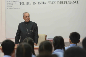 President Pranab Mukherjee teaching students in a class at a government school on Teacher's Day in New Delhi on Monday. Credit: Twitter