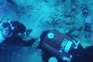 Divers investigate the shipwreck where the Antikythera mechanism was found. Source: Nature/YouTube