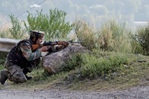 An Army soldier takes position near Army Brigade camp during a terror attack in Uri Jammu and Kashmir on Sunday. Credit: PTI
