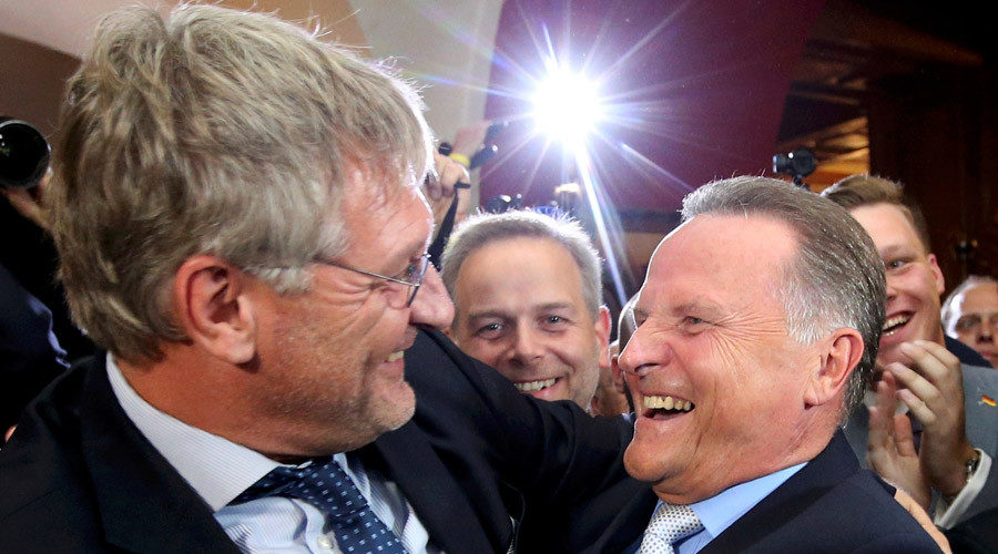 Top candidate of the anti-immigration party Alternative for Germany (AfD) Georg Pazderski and AfD co-leader Joerg Meuthen (L)react after first exit polls of the Berlin city-state elections, Germany September 18, 2016. Credit: Reuters