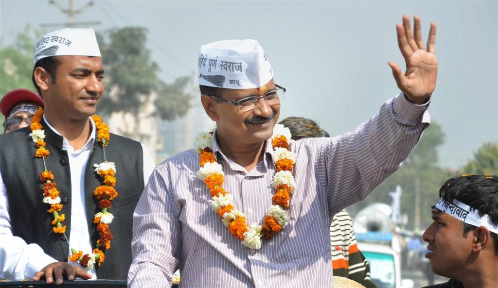 Faridabad : AAP convener Arvind Kejriwal during an election road show in Faridabad on Saturday. Credit: PTI