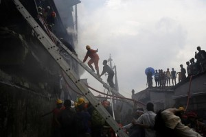 Firefighters extinguish a fire at a garment packaging factory outside of Dhaka, Bangladesh, September 10, 2016. Reuters/Mohammad Ponir Hossain